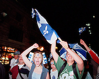 Montreal, June 23 , 2000 File Photo<br /> Young adults wave Quebec flags during Quebec National Holliday parade, June 23, 2000 in Montreal.<br /> <br /> Named after Quebec Patron ; Saint Jean Baptiste, the holliday is celebrated June 24 by free outdoor concerts and activities troughout the Quebec province.<br /> It provide an oppourtunity to Quebecer of all origins to unite and also for those in favor of Quebec Independance to express themselves.<br /> <br /> (Photo by Pierre Roussel / Getty Images) <br /> NOTE :  raw scan from color neg. , saved as Adobe 1998 RGB Color space