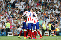 Raul Garcia, Arda Turan, Manzukiz and Koke of Atletico de Madrid during La Liga match between Real Madrid and Atletico de Madrid at Santiago Bernabeu stadium in Madrid, Spain. September 13, 2014. (ALTERPHOTOS/Caro Marin)