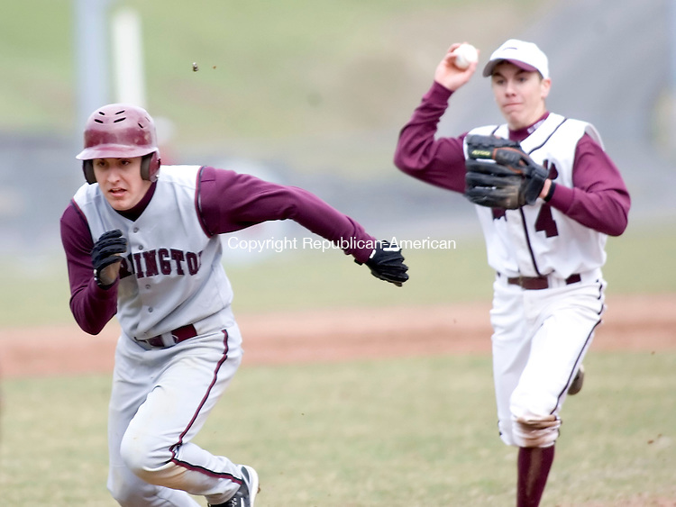 NAUGATUCK, CT- 05 APRIL 07- 040507JT08-- <br /> Torrington's Greg Bodnar, left, runs away from Naugatuck's Mike Gallo towards first base as he's caught between first and second during Thursday's game in Naugatuck. Bodnar was eventually tagged out at first base by pitcher Pat Dean. Naugatuck won 11-1.<br /> Josalee Thrift Republican-American