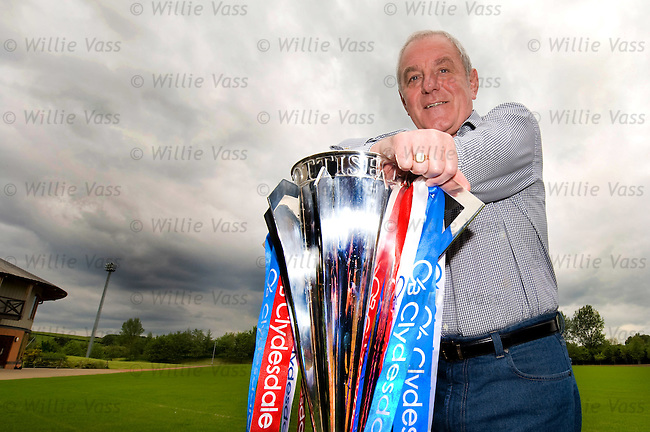 Walter Smith with the Scottish Premier League winners trophy at Murray Park