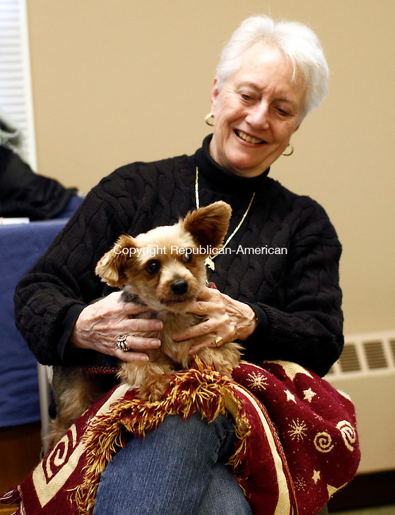 Middlebury, CT- 04 October 2014-100414CM01-  Louann Hart a volunteer with Rose Hope Animal Refuge of Waterbury, holds Little Trooper, a rescued Yorkshire Terrier, during St. George's Episcopal Church annual Blessing of the Animals  in Middlebury on Saturday.    Christopher Massa Republican-American