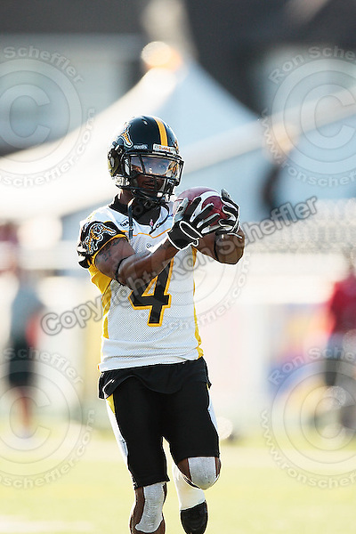 Aug 3, 2007; Hamilton, ON, CAN; Winnipeg Blue Bombers play the Hamilton Tiger-Cats at Ivor Wynne Stadium. The Tiger-Cats defeated the Blue Bombers 43-22. Mandatory Credit: Ron Scheffler. Pictured here is Hamilton Tiger-Cats defensive back (4) Tay Cody.