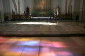 "Pools of coloured light from the stained glass window, ""Service"", by Mark Angus on the floor.  Looking towards the High Altar of Guildford Cathedral."