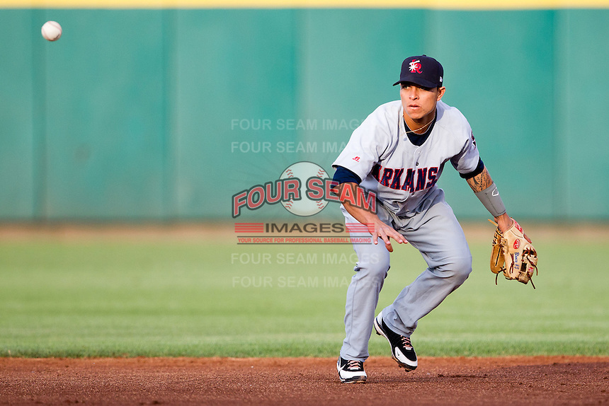 Darwin Perez (6) of the Arkansas Travelers tosses a ball to second for a double play during a game against the Springfield Cardinals at Hammons Field on June 12, 2012 in Springfield, Missouri. (David Welker/Four Seam Images).