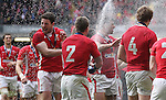 Try scorer Alex Cuthbert celebrates the Grand Slam victory over France..RBS 6 Nations 2012.Wales v France.Millennium Stadium.17.03.12..CREDIT: STEVE POPE-SPORTINGWALES
