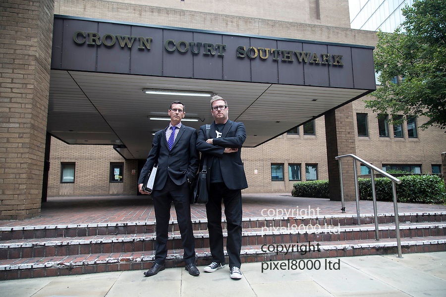 Pic shows: Tim Harries  - glasses - purple tie - after appearing at Southwark Crown Court today. 17.9.13<br /> <br /> Seen here with founder of Fathers 4 Justice Matt O'Connor  - right -<br /> <br /> A Fathers4Justice campaigner appeared in court today accused of defacing a portrait of the Queen in Westminster Abbey.<br /> <br /> Tim Haries, 41, is alleged to have smuggled a can of spray paint into the abbey yesterday before defacing the picture.<br /> <br /> He appeared at Court charged with criminal damage of more than £5,000.<br /> <br /> <br /> <br /> <br /> Pic by Gavin Rodgers/Pixel 8000 Ltd