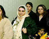 McLean, VA - December 13, 2005 -- Fatima Youssif, center, who emigrated to Binghamton, New York from Duhua, Iraq to escape being gassed by Saddam Hussein waits to pass through the security check to vote in the Iraqi election in McLean, Virginia on December 13, 2005.  With her are Shraen Ababkir, right center, and Shoresh Audel, right..Credit: Ron Sachs / CNP.(RESTRICTION: NO New York or New Jersey Newspapers or newspapers within a 75 mile radius of New York City)