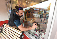 NWA Democrat-Gazette/FLIP PUTTHOFF <br />CLEAR AS GLASS<br />Sayer Canova cleans windows Tuesday Nov. 6 2018 in downtown Bentonville. Canova was washing windows at the Walmart Museum on the town square.