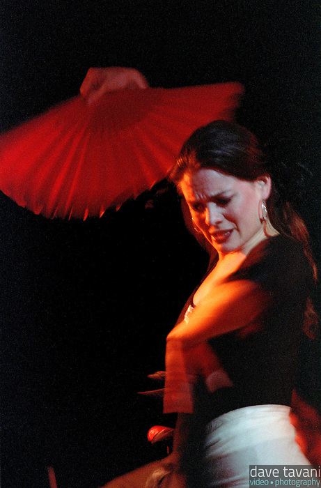 A flamenco dancer twirls her fan in the Uptown section of New Orleans.