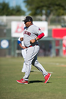Glendale Desert Dogs pitching coach Rigo Beltran (47), of the Cleveland Indians organization, jogs off the field after visiting the pitcher's mound during an Arizona Fall League game against the Surprise Saguaros at Surprise Stadium on November 13, 2018 in Surprise, Arizona. Surprise defeated Glendale 9-2. (Zachary Lucy/Four Seam Images)