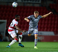 Lincoln City's Harry Anderson vies for possession with Doncaster Rovers' Cameron John<br /> <br /> Photographer Andrew Vaughan/CameraSport<br /> <br /> EFL Leasing.com Trophy - Northern Section - Group H - Doncaster Rovers v Lincoln City - Tuesday 3rd September 2019 - Keepmoat Stadium - Doncaster<br />  <br /> World Copyright © 2018 CameraSport. All rights reserved. 43 Linden Ave. Countesthorpe. Leicester. England. LE8 5PG - Tel: +44 (0) 116 277 4147 - admin@camerasport.com - www.camerasport.com