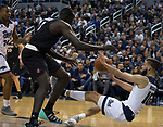 Nevada forward Caleb Martin (10) passes the ball to forward Jordan Caroline (24) as he falls against San Diego State in the first half of an NCAA college basketball game in Reno, Nev., Saturday, March 9, 2019. (AP Photo/Tom R. Smedes)
