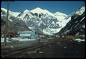 Somewhat distant view of Telluride and depot, looking east.<br /> RGS  Telluride, CO  Taken by August, Irving - 4/15/1949