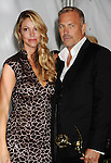 LOS ANGELES, CA - SEPTEMBER 23: Kevin Costner and Christine Baumgartner pose in the press room at the 64th Primetime Emmy Awards held at Nokia Theatre L.A. Live on September 23, 2012 in Los Angeles, California.