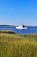 Lobster boat moored in Nauset Harbor, Orleans, Cape Cod, MA, USA
