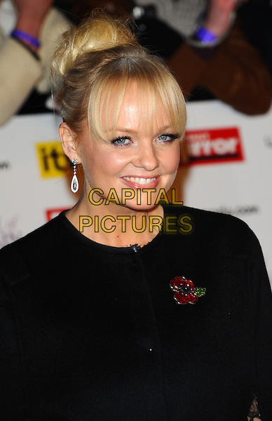 EMMA BUNTON .The Pride of Britain Awards 2010, Grosvenor House, Park Lane, London, England, UK, November 8th 2010 arrivals portrait headshot hair up bun fringe smiling black poppy .CAP/CJ.©Chris Joseph/Capital Pictures.