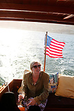 USA, California, San Francisco, a woman sits on the back of a restored 1927 Stevens on the San Francisco Bay, Tiburon