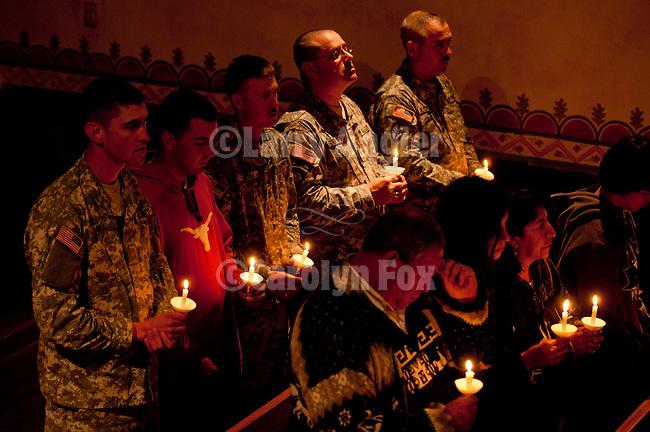 Candle light Easter Eve Vigil Service with members of the U.S. Army inside the chapel, Mission San Antonio de Padua, California.