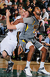 SPEARFISH, S.D. -- NOVEMBER 16, 2013 -- Riley Ryan #32 of Black Hills State gets tangled with Jonathan Mesghna #21 of Montana State - Billings while getting position for a rebound during their game Saturday at the Donald E. Young Center in Spearfish, S.D. (Photo by Dick Carlson/Inertia)