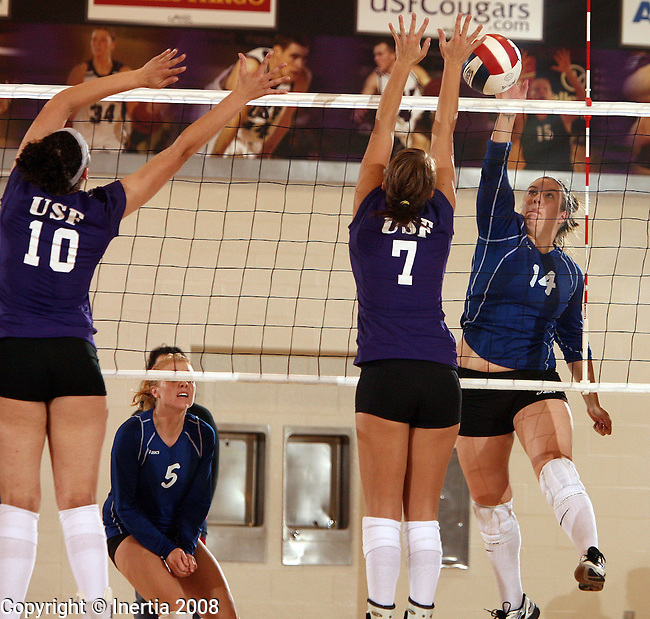 SIOUX FALLS, SD - NOVEMBER 4: Polly Gill #14 of Dakota Wesleyan tries for a kill attempt against Alyssa Chambers #10 and Amber Sneller #7 of the University of Sioux Falls in the second game of their match Tuesday night at the Stewart Center. (Photo by Dave Eggen/Inertia)