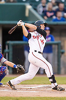 Lansing Lugnuts catcher Ryan Hissey (15) follows through on his swing against the South Bend Cubs on May 12, 2016 at Cooley Law School Stadium in Lansing, Michigan. Lansing defeated South Bend 5-0. (Andrew Woolley/Four Seam Images)