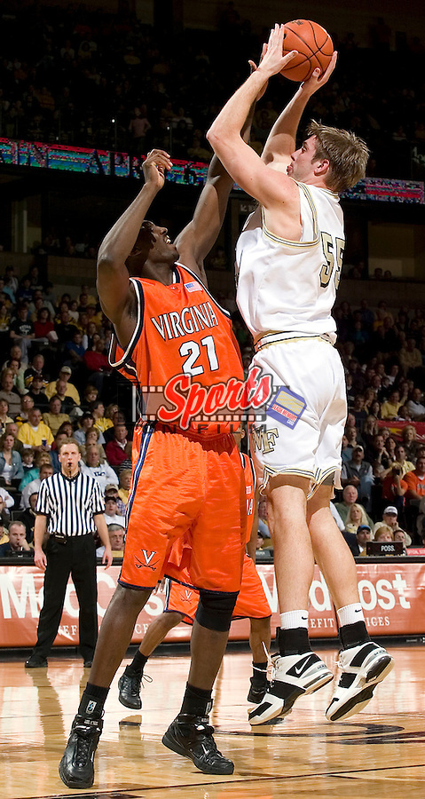 Wake Forest senior Kyle Visser (55) shoots over Virginia's Tunji Soroye (21) during first half action at the LJVM Coliseum in Winston-Salem, NC, Saturday, March 3, 2007.  The Demon Deacons upset the Cavaliers 78-72.
