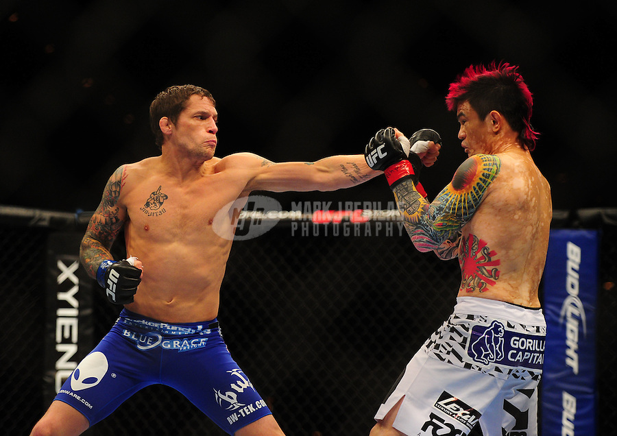 Oct. 29, 2011; Las Vegas, NV, USA; UFC fighter Scott Jorgensen (right) against Jeff Curran  during a featherweight bout during UFC 137 at the Mandalay Bay event center. Mandatory Credit: Mark J. Rebilas-