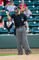 Home plate umpire Jansen Visconti makes a strike call during the Carolina League game between the Potomac Nationals and the Winston-Salem Dash at BB&T Ballpark on June 13, 2012 in Winston-Salem, North Carolina.  The Dash defeated the Nationals 5-3.  (Brian Westerholt/Four Seam Images)