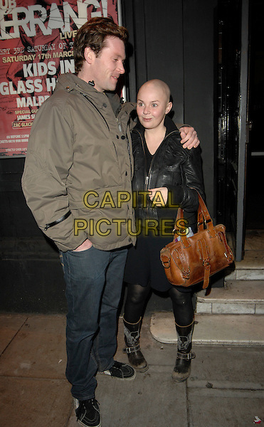 GAIL PORTER & GUEST.At the Smile '07 Benefit Gig, Koko Camden, London,.England, 18th February 2007..full length black jacket brown bag boots tights.CAP/CAN.©Can Nguyen/Capital Pictures