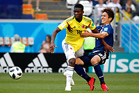 SARANSK - RUSIA, 19-06-2018: Jefferson LERMA (Izq) jugador de Colombia disputa el balón con Genki HARAGUCHI (Der) jugador de Japón durante partido de la primera fase, Grupo H, por la Copa Mundial de la FIFA Rusia 2018 jugado en el estadio Mordovia Arena en Saransk, Rusia. /  Jefferson LERMA (L) player of Colombia fights the ball with Genki HARAGUCHI (R) player of Japan during match of the first phase, Group H, for the FIFA World Cup Russia 2018 played at Mordovia Arena stadium in Saransk, Russia. Photo: VizzorImage / Julian Medina / Cont