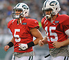 Quarterbacks Christian Hackenberg #5, left, and Josh McCown #15 of the New York Jets head to the sideline during the team's annual Green & White practice and scrimmage at MetLife Stadium in East Rutherford, NJ on Saturday, Aug. 5, 2017.