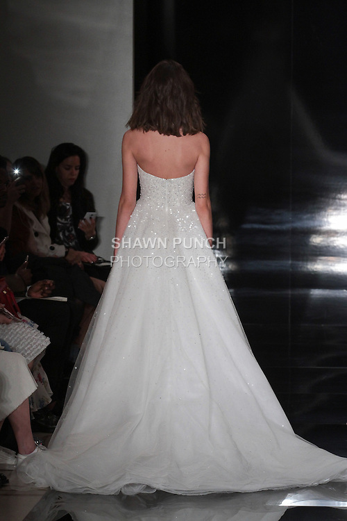 Model walks runway in a strapless embroidered tulle ball gown, from the Reem Acra Spring 2017 bridal collection, during New York Bridal Fashion Week Spring Summer 2017, on April 15, 2016.