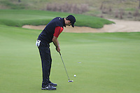 Ross Fisher (ENG) putts on the 4th green during Saturay's Round 3 of the 2014 BMW Masters held at Lake Malaren, Shanghai, China. 1st November 2014.<br /> Picture: Eoin Clarke www.golffile.ie