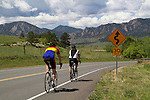 Men cycling on mountain road in Boulder, Colorado .  John leads private photo tours in Boulder and throughout Colorado. Year-round.