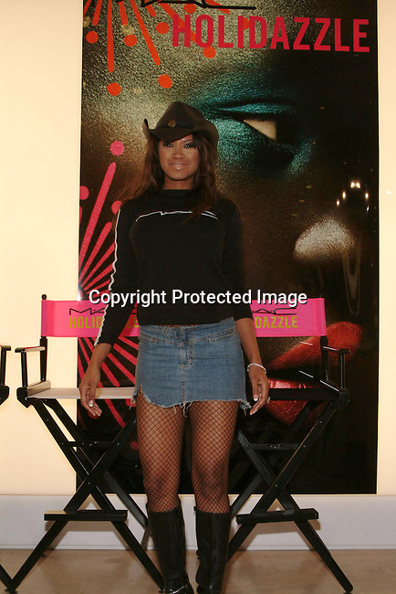 Traci Bingham<br />MAC AIDS Fund and Viva Glam on World Aids Day<br />MAC Store<br />Hollywood, CA, USA<br />December 1, 2003 <br />Photo By Celebrityvibe.com /Photovibe.com