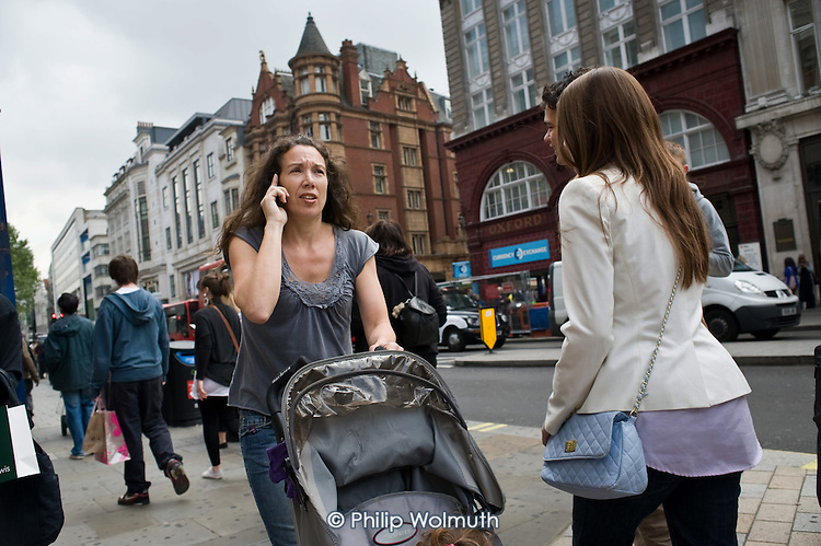 Pedestrians using mobile phones in Oxfrod Street, London.