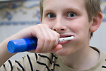 Boy with Autism cleaning his teeth. MR