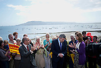 Prime Minister Gordon Brown is applauded by supporters including his wife Sarah (right) at a garden party in Weymouth organised by local members of the Labour Party.