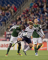 Portland Timbers midfielder James Marcelin (14) and New England Revolution forward Zack Schilawski (15) battle for the ball. In a Major League Soccer (MLS) match, the New England Revolution tied the Portland Timbers, 1-1, at Gillette Stadium on April 2, 2011.