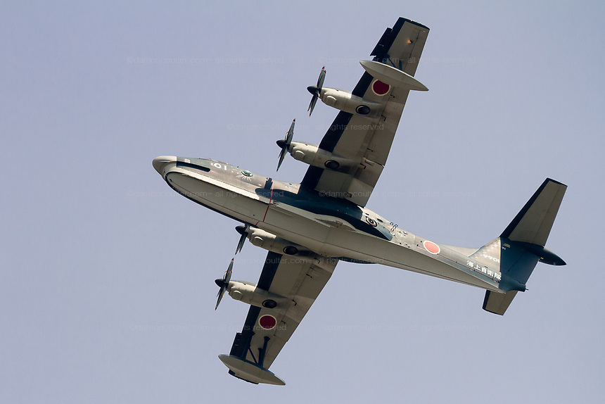 The underside of a  ShinMaywa US-2 flying boat, with the Japanese maritime Self Defence Force flying over Tsuruma, Kanagawa, Japan Friday April 13th 2018