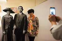 A tourist poses for pictures with paper cutouts of the Father of Modern China, Dr. Sun Yat-sen (C) and his wife Soong Ching-ling (L) at the National Dr. Sun Yat-sen Memorial Hall in Taipei, Taiwan, 2015.