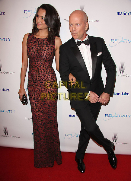 EMMA HEMING & BRUCE WILLIS.Relativity Weinstein Company 68th Annual Golden Globe Awards After Party Presented by Marie Claire held at the Beverly Hilton, Beverly Hills, California, USA..January 16th, 2011.full length black tuxedo red burgundy maroon print dress sleeveless arms linked dance dancing posing funny married husband wife .CAP/ADM/TB.©Tommaso Boddi/AdMedia/Capital Pictures.