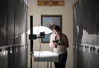 Ella Fornari '15 photographs hummingbird specimens in the Moore Lab as part of a CDLR funded project, July 8, 2014. (Photo by Marc Campos, Occidental College Photographer)