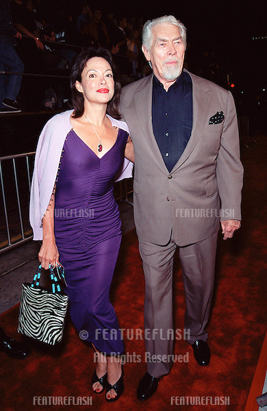"08NOV99: Actor JAMES COBURN & wife PAULA at world premiere, in Los Angeles,  of the new James Bond movie ""The World Is Not Enough""..© Paul Smith / Featureflash"