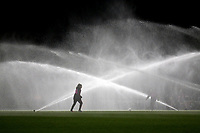 The sprinklers in use as a player warms up during Arsenal Women vs Manchester United Women, FA WSL Continental Tyres Cup Football at Meadow Park on 7th February 2019