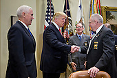 U.S. President Donald Trump, center, shakes hands with John Aubrey, sheriff from Jefferson County, Kentucky, as he arrives with U.S. Vice President Mike Pence, left, for a listening session with county sheriffs  in the Roosevelt Room of the White House in Washington, D.C., U.S., on Tuesday, Feb. 7, 2017. The Trump administration will return to court Tuesday to argue it has broad authority over national security and to demand reinstatement of a travel ban on seven Muslim-majority countries that stranded refugees, triggered protests and handed the young government its first crucial test. <br /> Credit: Andrew Harrer / Pool via CNP