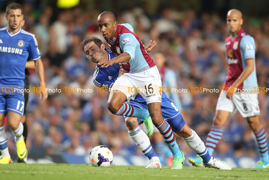 Fabian Delph of Aston Villa powers past Frank Lampard of Chelsea - Chelsea vs Aston Villa - Barclays Premier League Football at Stamford Bridge, Fulham Road, London - 21/08/13 - MANDATORY CREDIT: Simon Roe/TGSPHOTO - Self billing applies where appropriate - 0845 094 6026 - contact@tgsphoto.co.uk - NO UNPAID USE