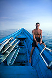 INDONESIA, Mentawai Islands, Kandui Resort, portrait of a surfer sitting in a boat