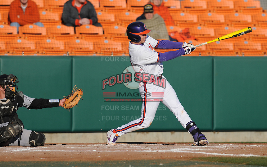 Third baseman Jay Baum (13) of the Clemson Tigers in a game against the Wofford Terriers on Wednesday, March 6, 2013, at Doug Kingsmore Stadium in Clemson, South Carolina. Clemson won, 9-2. (Tom Priddy/Four Seam Images)..