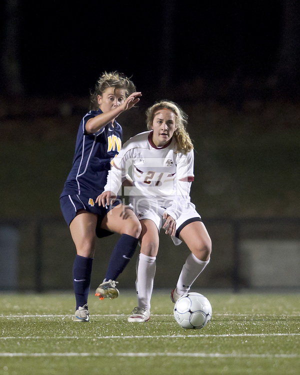 "West Virginia midfielder Bri Rodriguez (4) and Boston College midfielder Kate McCarthy (21) battle for the ball. Boston College defeated West Virginia, 4-0, in NCAA tournament ""Sweet 16"" match at Newton Soccer Field, Newton, MA."